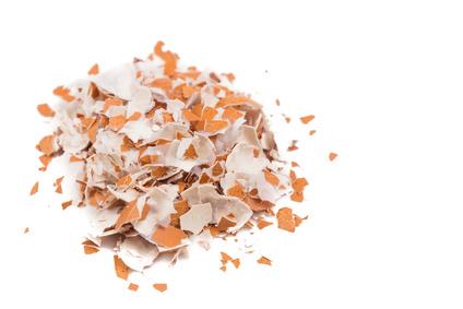 Crushed egg shell on white background flushed left