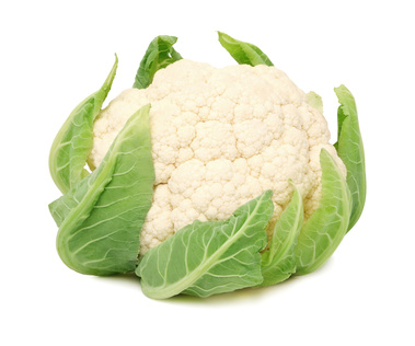 Head of ripe cauliflower with green leaves (isolated)