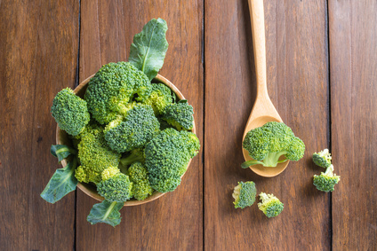 Raw broccoli on wooden background